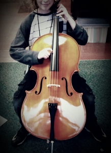 A new student playing cello for the first time!